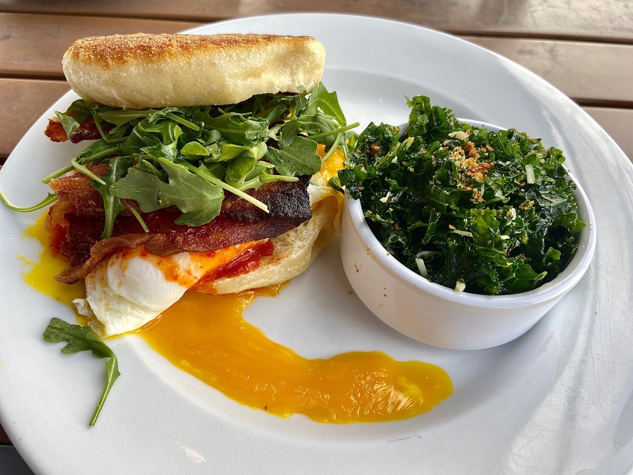 breakfast sandwich make with bacon, gruyere cheese, and arugula....